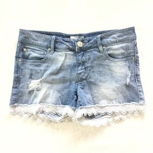 Distressed denim and lace shorts